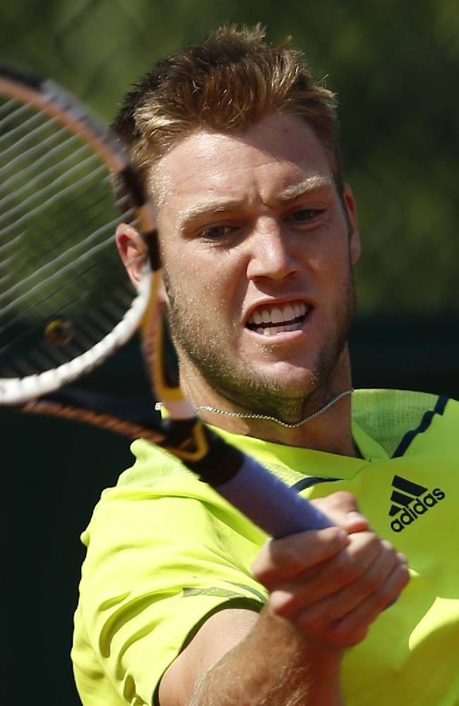 Jack Sock, of the U.S, slams a forehand to  Serbia's Dusan Lajovic during their third round match of  the French Open tennis tournament at the Roland Garros stadium, in Paris, France, Saturday, May 31, 2014