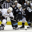Anaheim Ducks' Saku Koivu, left, of Finland, works against San Jose Sharks' Logan Couture (39) during a face-off in the second period of an NHL hockey game Thursday, March 20, 2014, in San Jose, Calif The Associated Press
