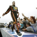 Tony Stewart greets fans during driver introductions before the NASCAR Daytona 500 Sprint Cup Series auto race at Daytona International Speedway, Sunday, Feb. 24, 2013, in Daytona Beach, Fla. (AP Photo/John Raoux)