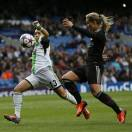 Wolfsburg's captain Nadine Kessler, left, vies for the ball with Lyon's Amandine Henry during the Women's Champions League final soccer match between Wolfsburg and Olympique Lyonnais at Stamford Bridge Stadium in London Thursday, May 23, 2013. (AP Photo/Kirsty Wigglesworth)