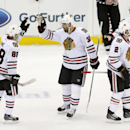 Chicago Blackhawks right wing Patrick Kane (88) is congratulated by Michal Rozsival (32), of the Czech Republic, after the Blackhawks beat the New Jersey Devils 3-2 during a shootout in an NHL hockey game, Tuesday, Dec. 9, 2014, in Newark, N.J The Associa