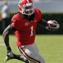 FILE - In this Oct. 1, 2011, file photo, Georgia running back Isaiah Crowell runs the ball during an NCAA college football game against the Mississippi State in Athens, Ga.  Crowell faces felony weapons charges after police found a gun in his vehicle early Friday morning, June 29, 2012. Athens-Clarke Police Department spokeswoman Hilda Sorrow says Crowell was arrested at a vehicle checkpoint on the UGA campus at around 2:20 a.m. Among the charges he faces are carrying a concealed weapon and possession of a weapon on school property. (AP Photo/John Bazemore, File)