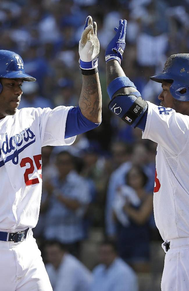 Los Angeles Dodgers' Carl Crawford (25) is congratulated by Hanley Ramirez after hitting a home run during the fifth inning of Game 5 of the National League baseball championship series against the St. Louis Cardinals Wednesday, Oct. 16, 2013, in Los Angeles