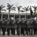 FILE - In this May 29, 2013 file photo, Soldiers line up with their shields during a security drill at the Maracana stadium in Rio de Janeiro, Brazil. No matter how well Brazil does hosting the Confederations Cup, it will be hard to say the country succeeded in its preparations. There were delays and cost overruns in stadiums across the country, few infrastructure projects were completed and the nation's capacity to host the tournament was put in doubt several times. (AP Photo/Felipe Dana, File)