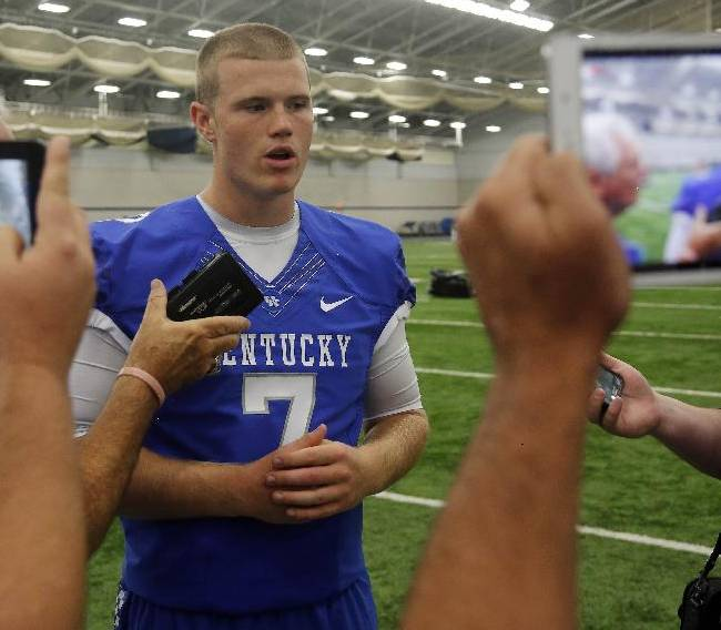 Kentucky's Drew Barker is interviewed during the team's NCAA college football media day, Friday, Aug. 8, 2014, in Lexington, Ky