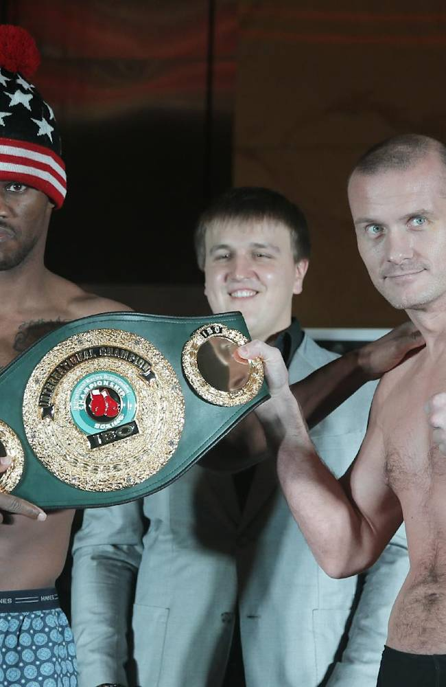 Vyacheslav Uzelkov from Ukraine, right, and Jaidon Codrington from the U.S pose for a photo at the official weigh in Kiev, Ukraine, Friday, Nov. 8, 2013. Uzelkov will fight with Jaidon Codrington for vacant International Boxing Organization International light heavyweight title in Kiev on Saturday