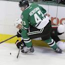 Ottawa Senators defenseman Marc Methot (3) is knocked to the boards by Dallas Stars right wing Valeri Nichushkin (43) during the third period of an NHL Hockey game, Saturday, March 22, 2014, in Dallas. The Stars won 3-1 The Associated Press
