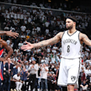 BROOKLYN, NY - APRIL 27: Deron Williams #8 of the Brooklyn Nets high fives teammates during Game Four of the Eastern Conference Quarterfinals against the Atlanta Hawks during the NBA Playoffs on April 27, 2015 at Barclays Center in Brooklyn, NY. (Photo by Nathaniel S. Butler/NBAE via Getty Images)
