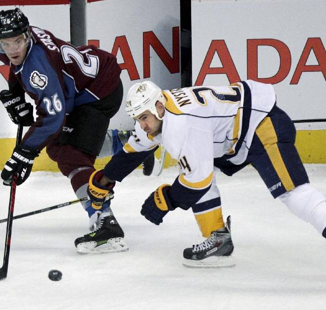 Colorado Avalanche's Paul Stastny (26) makes a pass past Nashville Predators' Eric Nystrom (24) during the first period of an NHL hockey game Wednesday, Nov. 6, 2013, in Denver