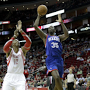 Philadelphia 76ers' Henry Sims (35) shoots over Houston Rockets' Dwight Howard (12) during the first half of an NBA basketball game on Thursday, March 27, 2014, in Houston The Associated Press