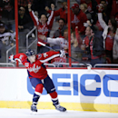 Washington Capitals defenseman John Carlson (74) celebrates his goal in the first period of an NHL hockey game against the Arizona Coyotes, Sunday, Nov. 2, 2014, in Washington The Associated Press