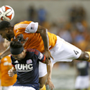 Houston Dynamo defender Jermaine Taylor (4) goes up and over New England Revolution midfielder Lee Nguyen (24) during the first half of an MLS soccer match at BBVA Compass Stadium, Thursday, Oct. 16, 2014, in Houston The Associated Press