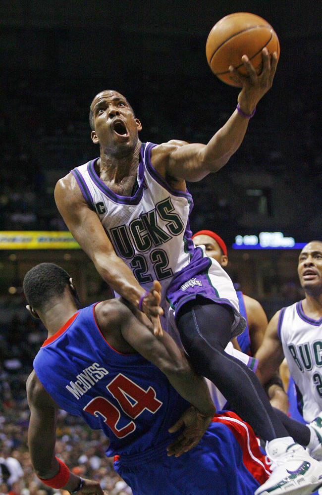 In this May 1, 2006 file photo, Milwaukee Bucks' Michael Redd puts up a shot over Detroit Pistons' Antonio McDyess (24) during the first quarter of their first-round NBA basketball playoff game , in Milwaukee. Redd, a former All-Star guard who became the fourth-leading scorer in Bucks history in a career hampered by injuries, will retire in Milwaukee on Wednesday. The team announced Redd's decision Tuesday, Nov. 5, 2013, and said he will make a formal announcement when Milwaukee hosts Cleveland