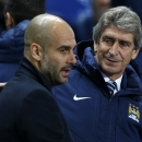 FILE - In this Tuesday, Nov. 25, 2014 file photo, Manchester City's coach Manuel Pellegrini, right, speaks with Bayern Munich's coach Pep Guardiola before their Champions League group E soccer match at the Etihad Stadium, in Manchester, England. M