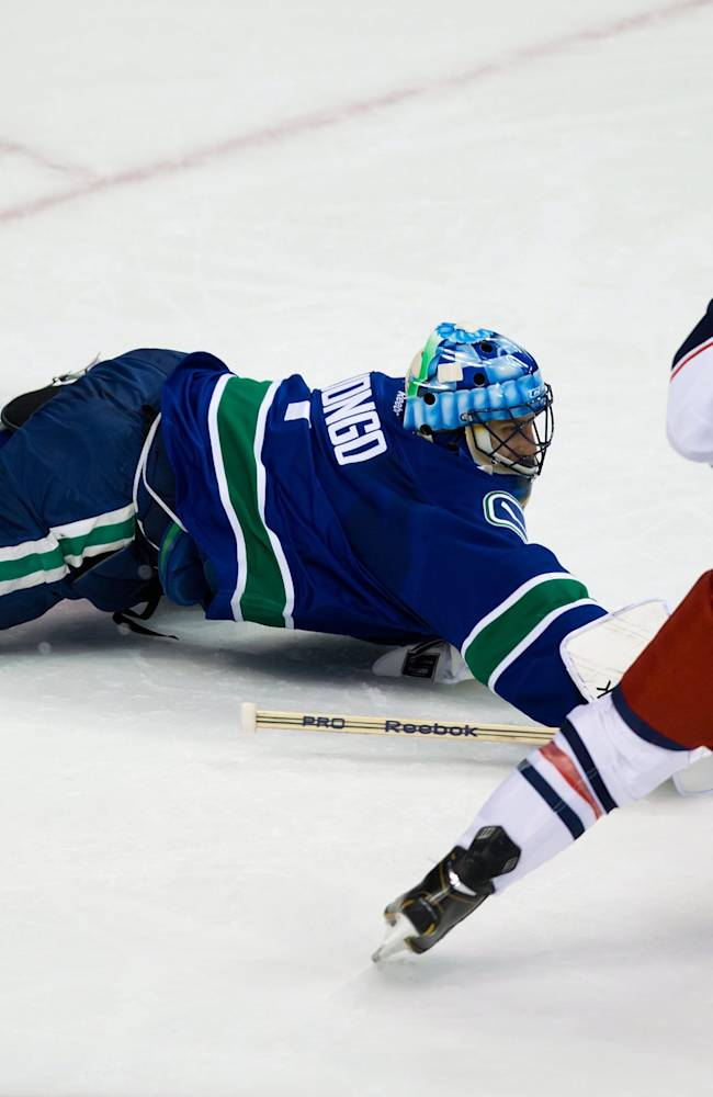 Sedin brothers lead Canucks past Blue Jackets, 6-2