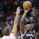 Brooklyn Nets guard Joe Johnson (7) goes up for a shot against Miami Heat forward Shane Battier (31) during the second half of an NBA basketball game, Tuesday, April 8, 2014 in Miami. Johnson scored 19 points as the Nets defeated the Heat 88-87 The Associ