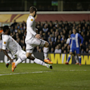 Tottenham's Emmanuel Adebayor, left, scores their second goal during the Europa League Group K soccer match between Tottenham Hotspur and Dnipro at White Hart Lane stadium in London, Thursday, Feb. 27, 2014