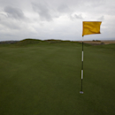 The flag lies on the wind on the 14th hole at Royal Liverpool Golf Club before the British Open golf championships, Hoylake, England, Wednesday, April 23, 2014. The 2014 Open Championship which will be played at Royal Liverpool from July 17-20, 2014