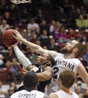 Montana forward Derek Selvig, right rear, blocks the shot of Northern Arizona guard Durrell Norman as Montana's Art Steward (1) and Shawn Stockton (22) look on during the first half of an NCAA college basketball game in Missoula, Mont., on Thursday, Feb. 23, 2012. (AP Photo/ Michael Albans)