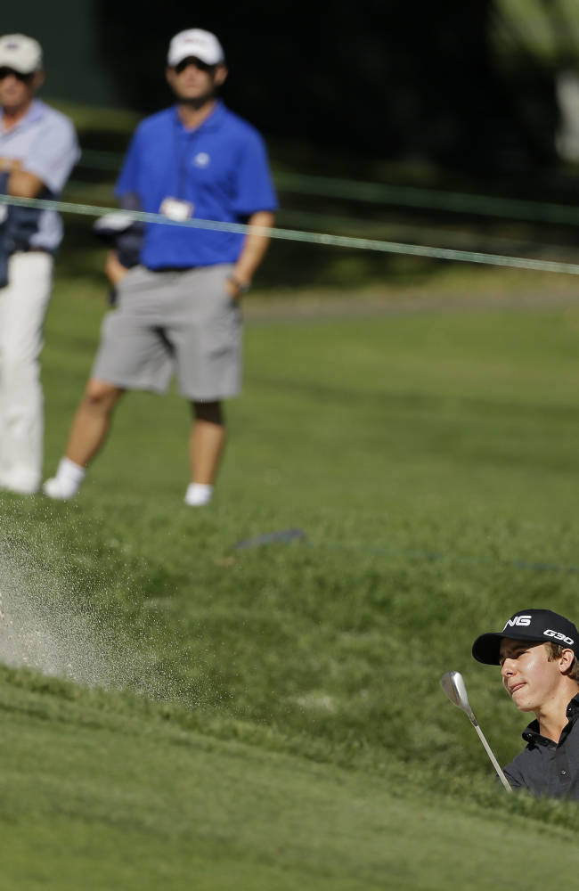 In this Oct. 10, 2014, file photo, Carlos Ortiz, of Mexico, hits out of a bunker up to the second green of the Silverado Resort North Course during the second round of the Frys.com PGA Tour golf tournament in Napa, Calif. The Web.com Tour player of the year last season, the 23-year-old from the home club of Lorena Ochoa gives Mexico hopes of having another star