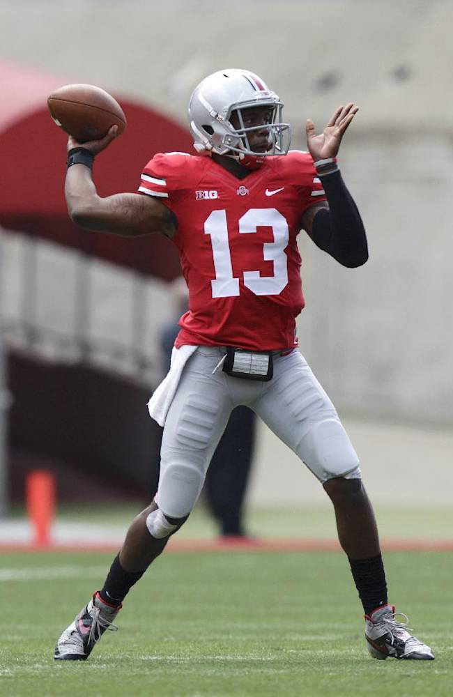 Ohio State quarterback Kenny Guiton throws a pass against Florida A&M during the first quarter of an NCAA college football game Saturday, Sept. 21, 2013, in Columbus, Ohio