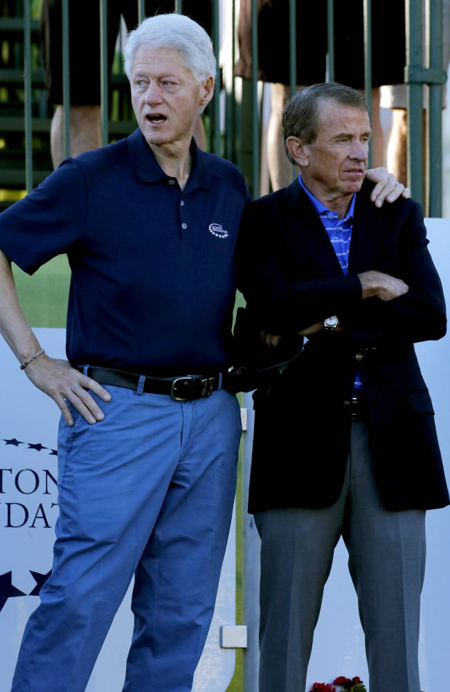 Former President Bill Clinton, left, stands with PGA Tour Commissioner Tim Finchem prior to the start of the first round of the Humana Challenge PGA golf tournament on the Palmer Private course at PGA West, Thursday, Jan. 16, 2014, in La Quinta, Calif