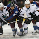 Colorado Avalanche center Ryan O'Reilly, center, fights for control of puck with San Jose Sharks left wing Patrick Marleau, left, and center Tommy Wingels in the third period of the Sharks' 3-2 shootout victory in an NHL hockey game in Denver on Tuesday,