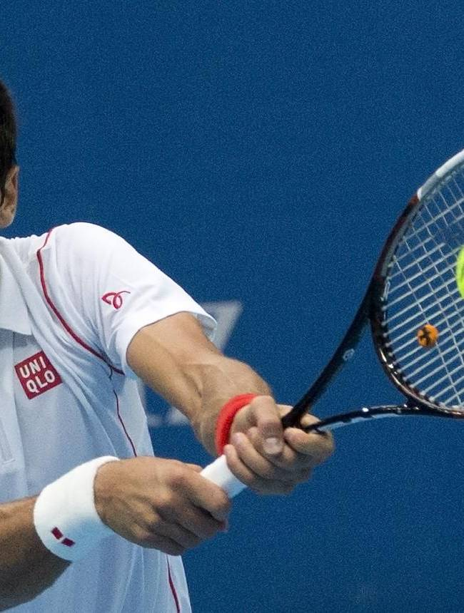 Novak Djokovic of Serbia returns a shot against Lukas Rosol of the Czech Republic during the China Open tennis tournament at the National Tennis Stadium in Beijing, China Tuesday, Oct. 1, 2013
