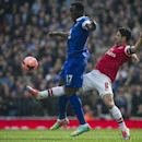 Arsenal's Mikel Arteta, fights for the ball with Everton's Romelu Lukaku, during their FA Cup quarterfinal soccer match, at Emirates Stadium, in London, Saturday, March 8, 2014