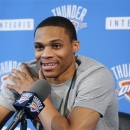 Oklahoma City Thunder injured guard Russell Westbrook smiles as he answers a question during a news conference in Oklahoma City, Thursday, May 16, 2013. After making it to the NBA Finals last season, Oklahoma City couldn't make it out of the second round this year with Westbrook sidelined. (AP Photo/Sue Ogrocki)