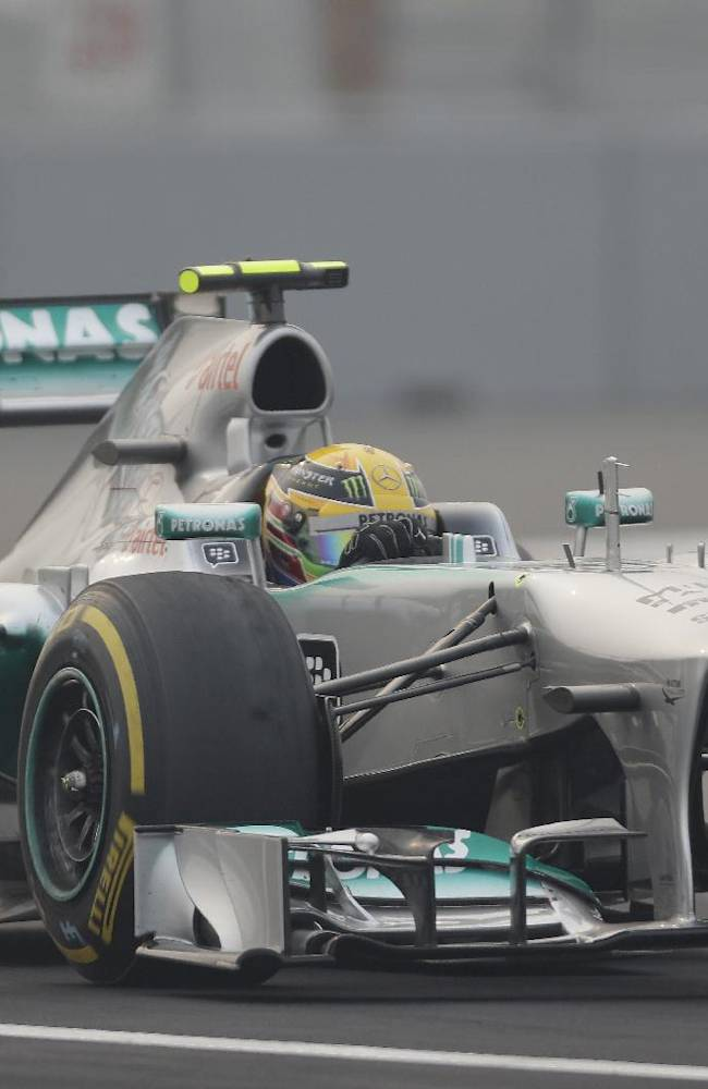 Mercedes driver Lewis Hamilton of Britain steers his car during the second practice session at the Indian Formula One Grand Prix at the Buddh International Circuit in Noida, India, Friday, Oct. 25, 2013