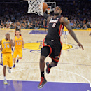 In this Jan. 17, 2013, file photo, Miami Heat forward LeBron James, second from right, goes up for a dunk as Los Angeles Lakers guard Kobe Bryant, left, guard Steve Nash, second from left, and forward Metta World Peace look on during the first half of the