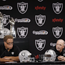 Oakland Raiders general manager Reggie McKenzie, left, and interim coach Tony Sparano answer questions from reporters during a news conference Tuesday, Sept. 30, 2014, in Alameda, Calif. The Raiders named Sparano as interim coach a day after the firing of coach Dennis Allen. (AP Photo/Ben Margot)