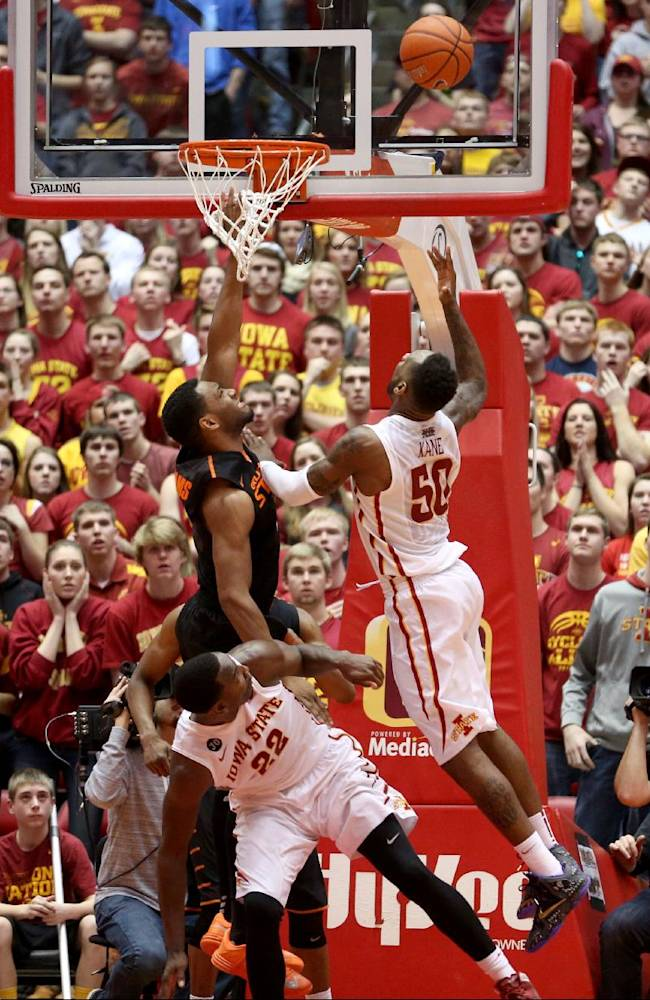 Iowa State guard DeAndre Kane puts up a shot over Oklahoma State guard/forward Brian Williams with less 30 second to go during overtime of an NCAA college basketball game in Ames, Iowa, Saturday, March 8, 2014. Kane made the basket and Iowa State won the game 85-81
