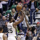 Utah Jazz's Al Jefferson (25) shoots as Portland Trail Blazers' J.J. Hickson (21) defends in the first quarter during an NBA basketball game Monday, April 1, 2013, in Salt Lake City. (AP Photo/Rick Bowmer)