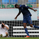 France's Yaya Sanogo, right, celebrates after scoring the opening goal during the Under-20 World Cup quarterfinal soccer match between France and Uzbekistan in Rize, Turkey, Saturday, July 6 2013. (AP Photo/Armando Franca)