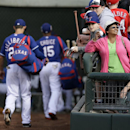 Texas Rangers' Brent Lillibridge (20) and Michael Choice (15) walk back to the clubhouse as fans seek autographs in the sixth inning of a spring training baseball game against the Chicago White Sox, Sunday, March 2, 2014, in Surprise, Ariz The Associated