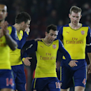 Arsenal's Santi Cazorla, centre, talks with Arsenal's Per Mertesacker, right, and Arsenal's Laurent Koscielny, left, after losing the English Premier League soccer match between Southampton and Arsenal at St Mary's Stadium, Southampton, England, Thursday,