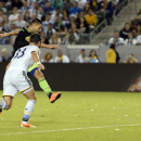 Seattle Sounders forward Clint Dempsey, back, kicks the ball to score a goal defended by Los Angeles Galaxy defender Dan Gargan, front, during the second half of an MLS soccer match in Carson, Calif., Sunday, Oct. 19, 2014. The game ended in a draw with a