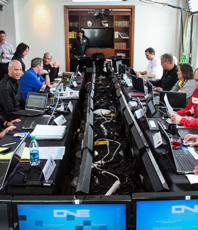 In this Friday March 14th, 2014, photo released by NCAA, the NCAA Division I men's college basketball tournament selection committees and the NCAA staff gather in the selection room in Indianapolis. Warren Buffett has promised a billion dollars for a perfect NCAA bracket, the chances of which are astronomically small. The NCAA March Madness tournament is to begin Tuesday