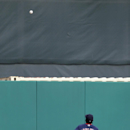 Boston Red Sox center fielder Jackie Bradley Jr. watches as a ball hit by St. Louis Cardinals' Jhonny Peralta bounces over an outfield fence for a ground-rule double scoring Daniel Descalso during the fourth inning of an exhibition spring training basebal