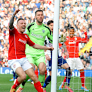 Cardiff's Craig Bellamy, left, celebrates after Steven Caulker scored an equalizer against West Brom during the English Premier League soccer match between West Bromwich Albion and Cardiff City at Hawthorns Stadium in West Bromwich, England, Saturday, Mar
