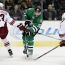 Phoenix Coyotes' Oliver Ekman-Larsson (23) and Jeff Halpern (14) defend against a shot on goal by Dallas Stars' Erik Cole (72) in the first period of an NHL hockey game, Saturday, Feb. 8, 2014, in Dallas The Associated Press