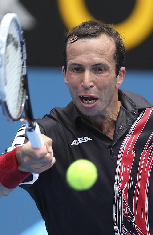 Radek Stepanek of the Czech Republic plays a shot in his quarterfinals match against Juan Martin del Potro of Argentina during the Sydney International tennis tournament in Sydney, Australia, Thursday, Jan. 9, 2014