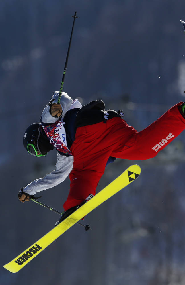Joss Christensen of the United States takes a jump during a ski slopestyle training session at the Rosa Khutor Extreme Park, prior to the 2014 Winter Olympics, Wednesday, Feb. 5, 2014, in Krasnaya Polyana, Russia. (AP Photo/Sergei Grits)