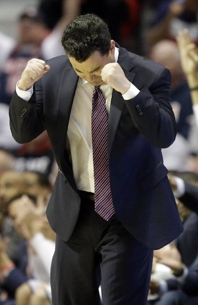 Arizona head coach Sean Miller gestures as his team plays Gonzaga during the second half of a third-round game in the NCAA college basketball tournament Sunday, March 23, 2014, in San Diego