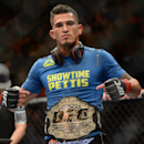 Dec 6, 2014; Las Vegas, NV, USA; Anthony Pettis (red) defeats Gilbert Melendez (blue) during UFC 181 at Madalay Bay Events Center. Pettis won via second round submission. (Joe Camporeale-USA TODAY Sports)