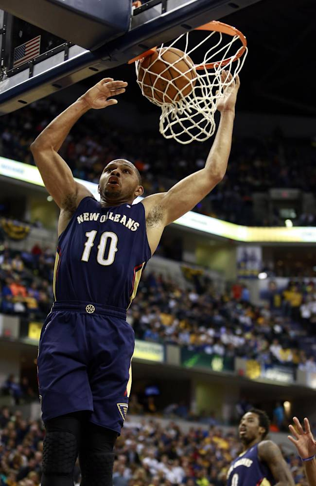 New Orleans Pelicans guard Eric Gordon (10) dunks against the Indiana Pacers during the second half of an NBA basketball game in Indianapolis, Saturday, Jan. 4, 2014. Indiana won 99-82