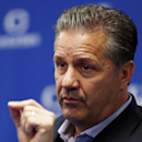 FILE - In this Oct. 16, 2014, file photo, Kentucky head coach John Calipari speaks to reporters during the team's NCAA college basketball media day in Lexington, Ky. The surprising returns of several starters from last year's NCAA runners-up has given Kentucky a 12-deep roster and created expectations of winning the national title. (AP Photo/James Crisp, File)