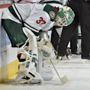 Minnesota Wild goalie Josh Harding pauses before the shootout during an NHL hockey game against the Colorado Avalanche on Saturday, Nov. 30, 2013, in Denver. Colorado won 3-2 The Associated Press